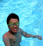 Smiling Boy in a Swimming Pool Stock Images