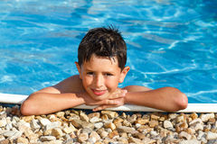 Smiling boy in the swimming pool Stock Image