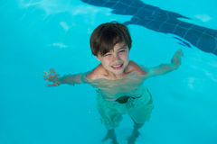 Smiling boy swimming in the pool. Portrait of smiling boy swimming in the pool at the leisure center Royalty Free Stock Images