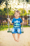 Smiling boy on a swing Royalty Free Stock Images