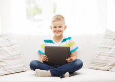Smiling boy with tablet computer at home Stock Photo