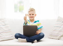 Smiling boy with tablet computer at home Stock Images