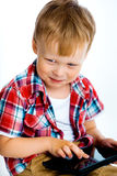 Smiling boy with a tablet computer Stock Images