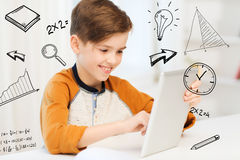 Smiling boy with tablet pc computer at home. Leisure, children, technology and people concept - smiling boy with tablet pc computer at home over mathematical Royalty Free Stock Images