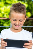 Smiling boy with tablet Royalty Free Stock Photos