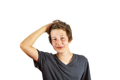 Smiling boy tearing his hair Stock Images