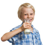Smiling boy about to drink bottle of milk. Royalty Free Stock Photo