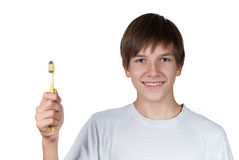 Smiling boy with toothbrush in hand isolated. On white background Stock Photo