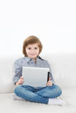 Smiling boy and touchpad Stock Photo