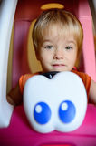 Smiling boy. In toy car Royalty Free Stock Photos