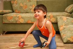 Smiling boy with toy cars in his hands Royalty Free Stock Images