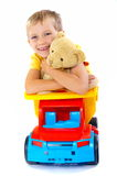 Smiling boy with toys Royalty Free Stock Images