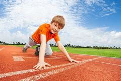 Smiling boy in uniform on the start ready to run Royalty Free Stock Images