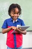 Smiling boy using digital tablet in classroom Royalty Free Stock Photos