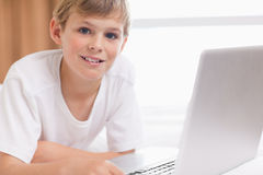 Smiling boy using a laptop Royalty Free Stock Photography