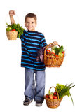 Smiling boy with vegetables in basket Royalty Free Stock Photo