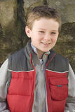 Smiling boy in vest Royalty Free Stock Images