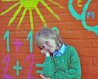 Smiling boy at wall Stock Images