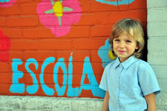 Smiling boy at the wall Stock Photography