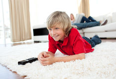 Smiling boy watching football match Stock Photos