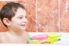 Smiling boy with water pistol Stock Image