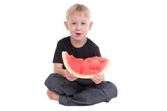 Smiling boy with watermelon Stock Photos