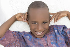 Smiling boy wearing an African garment, five years old Royalty Free Stock Photo