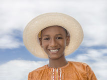 Smiling boy wearing a boater straw hat Royalty Free Stock Image