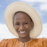 Smiling boy wearing a boater straw hat Stock Photo