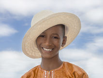 Smiling boy wearing a boater straw hat Stock Images
