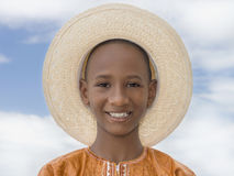 Smiling boy wearing a boater straw hat Royalty Free Stock Photos