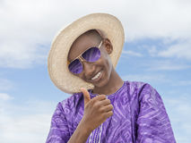 Smiling boy wearing a boater straw hat and a pair of sunglasses Royalty Free Stock Photo