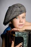 Smiling boy wearing a cap Royalty Free Stock Image