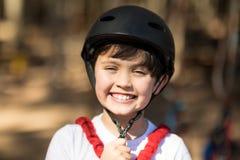 Boy wearing his helmet in park Stock Images