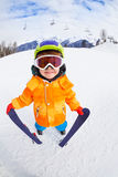 Smiling boy wearing mask holds ski in mountains Royalty Free Stock Photography