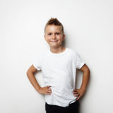 Smiling boy wearing white tshirt and shorts on the Royalty Free Stock Photos
