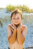 Smiling boy with wet hair at the beach Royalty Free Stock Image
