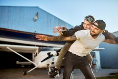 Free Smiling Boy With Model Plane, Riding On Father`s Back, Playing Outside Hangar Royalty Free Stock Photo - 153086355