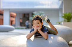 A smiling boy. A 7 years old boy smiling and he still has on his face remainings of face paintings Stock Photography
