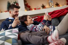 Boyfriend giving puppy dog as Christmas present to girlfriend Royalty Free Stock Photo