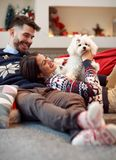 Boyfriend giving puppy dog as Christmas present to girlfriend Royalty Free Stock Photos