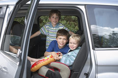 Smiling Boys In Car. Portrait of three smiling boys in the car Stock Photos