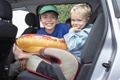 Smiling Boys In Car Stock Image