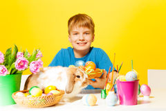 Smiling boys holds plate with Eastern eggs Royalty Free Stock Photos