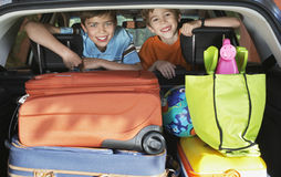 Smiling Boys In Loaded Car Royalty Free Stock Photo