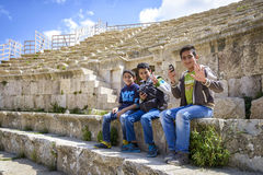 Smiling boys in the Roman Theater of Jerash in Jordan Royalty Free Stock Images