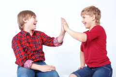 Smiling boys sitting on the floor Royalty Free Stock Images