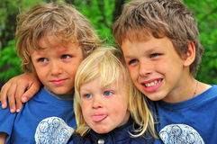 Smiling boys. Three Smiling boys in the park Royalty Free Stock Images