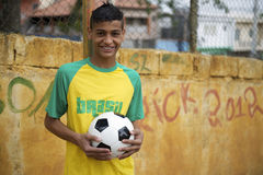 Smiling Brazilian Teen Standing with Football Soccer Ball Royalty Free Stock Photo