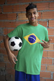 Smiling Brazilian Teen Stands with Football Soccer Ball Royalty Free Stock Photo